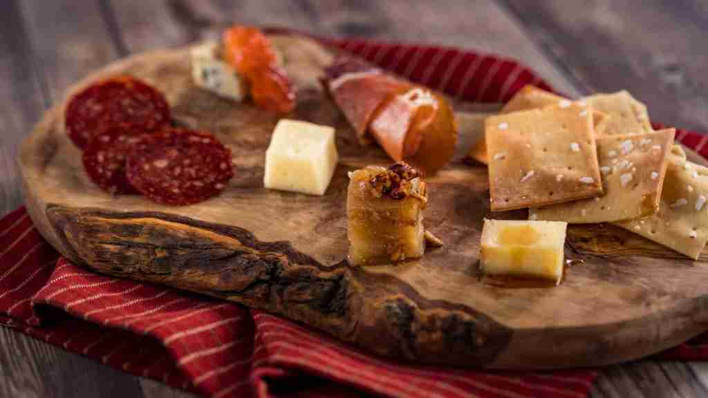 Guests can enjoy a Charcuterie and Cheese palette featuring gourmet meats and Belgioioso cheeses at the new Appleseed Orchard Marketplace during the 24th Epcot International Food & Wine Festival. The 87 day festival is a culinary mashup of global cultures and gourmet innovation, bringing bites, sips, entertainment and family fun to Epcot in Lake Buena Vista, Fla., Aug. 29 – Nov. 23. (Matt Stroshane, photographer)