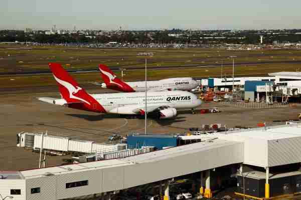 An Airbus SAS A380, front, and a Boeing 747 aircraft, both operated by Qantas Airways Ltd., stand at the International terminal at Sydney Airport in Sydney, Australia, on Monday, June 22, 2015. Australia