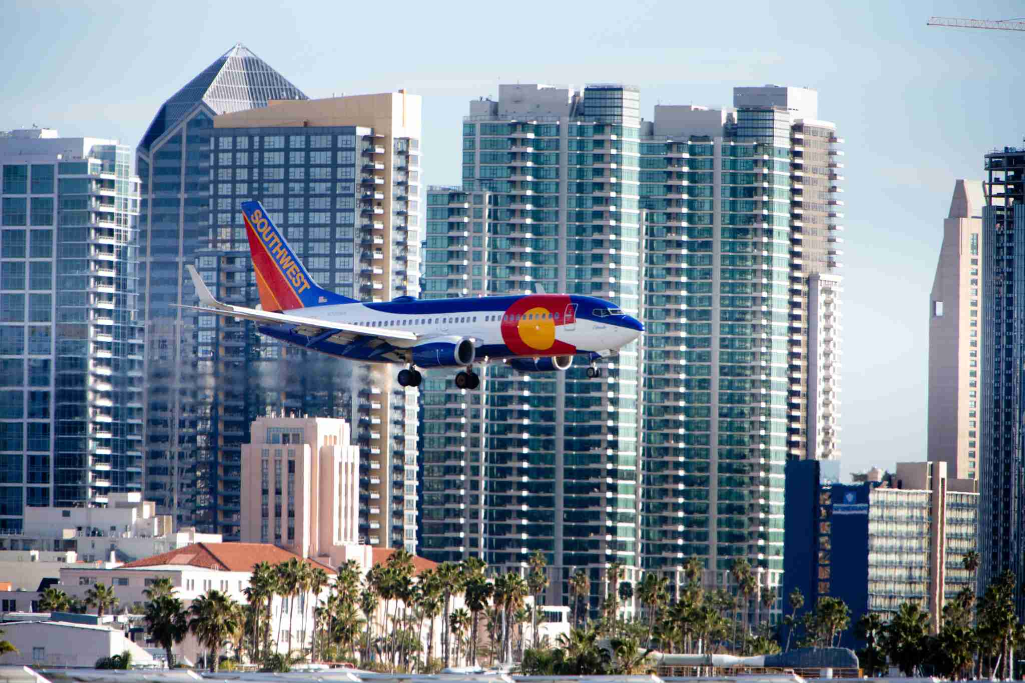 (GERMANY OUT) A Boeing 737 of Southwest Airlines approaching Lindbergh Field, with high rises of the San Diego skyline in the background. (Photo by Dünzl/ullstein bild via Getty Images)