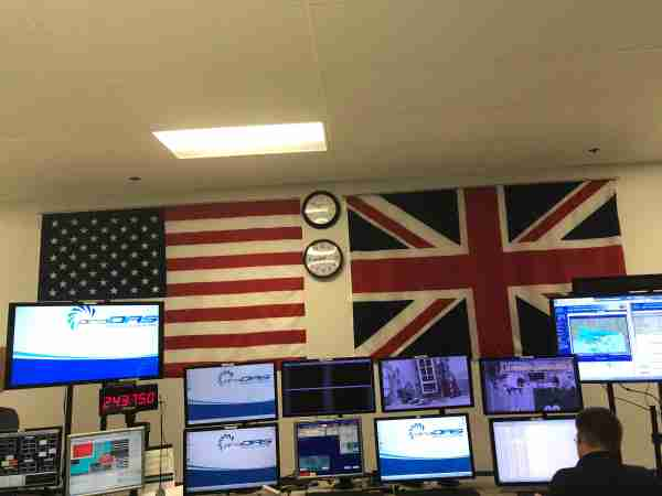 British and American flags side-by-side in the control room of a Rolls Royce jet engine test bed. Photo by Zach Wichter/TPG.