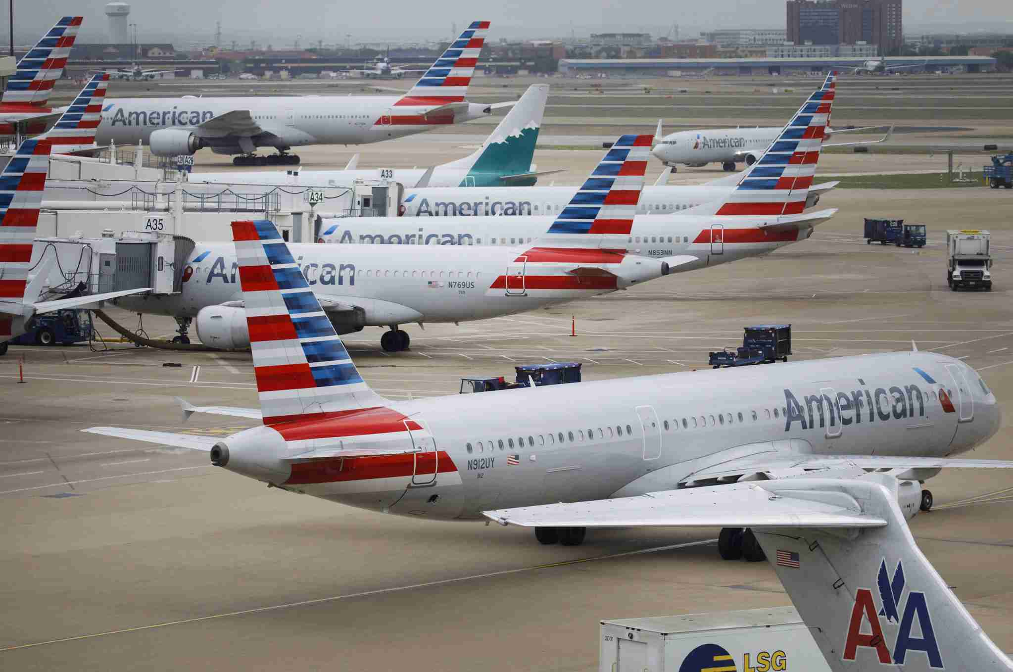 American Airlines Group Inc. planes stand at Dallas-Fort Worth International Airport (DFW) in Grapevine, Texas, U.S., on Friday, April 6, 2018. American Airlines is scheduled to release earnings figures on April 26. Photographer: Patrick T. Fallon/Bloomberg via Getty Images