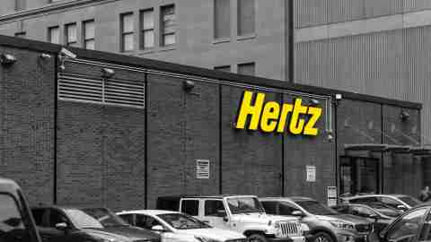Hertz storefront with cars parked outside
