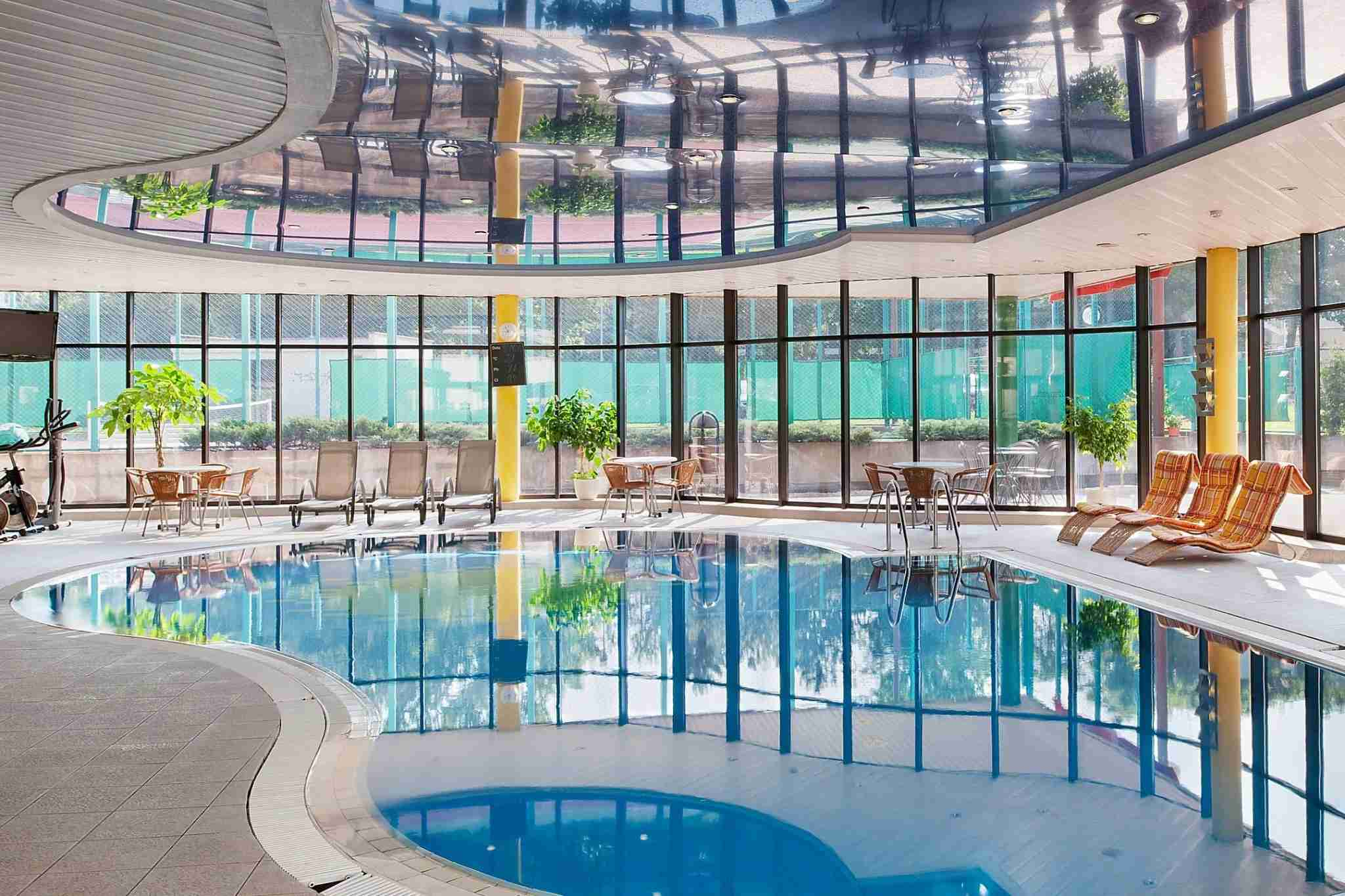 You can relax in the indoor pool or play tennis at the adjacent courts. (Photo courtesy of IHG.)