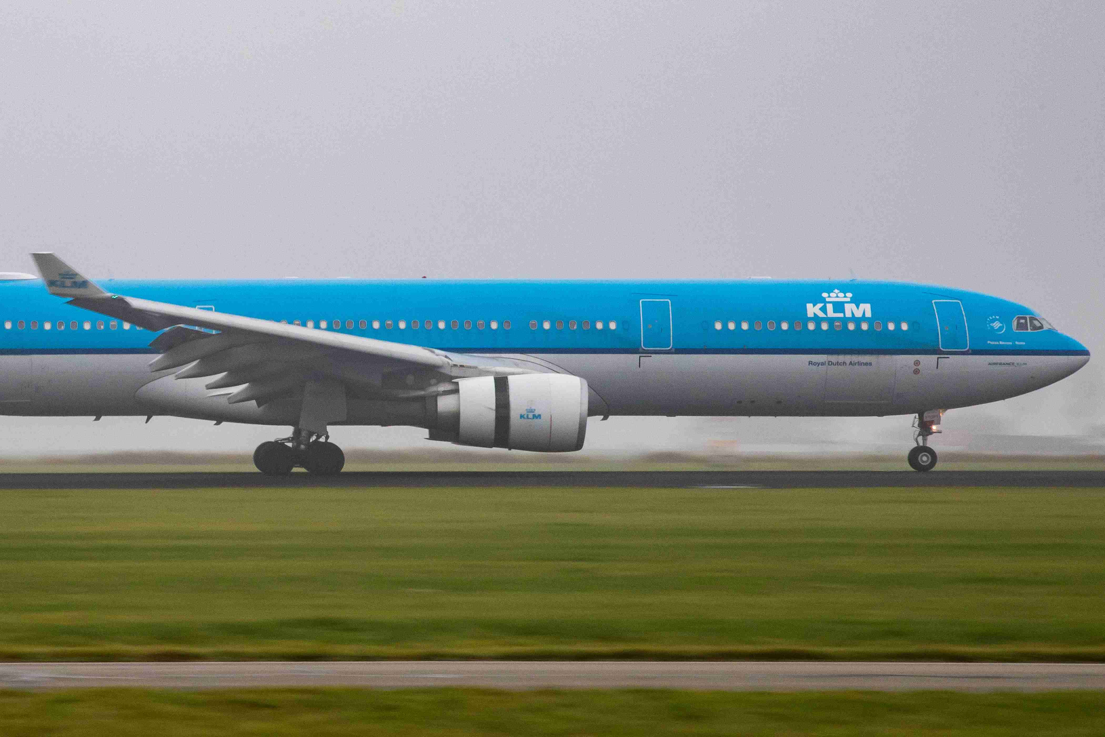 A KLM Airbus A330-300 lands in misty weather at Amsterdam Schiphol Airport (Photo by Nicolas Economou/SOPA Images/LightRocket via Getty Images)