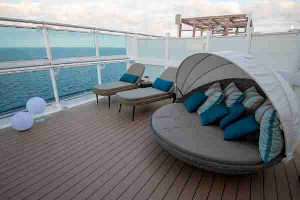 Sky Suites have a private outdoor lounge area with a clamshell lounger that swivels for views of the ocean.(Photo by Gene Sloan / The Points Guy.)