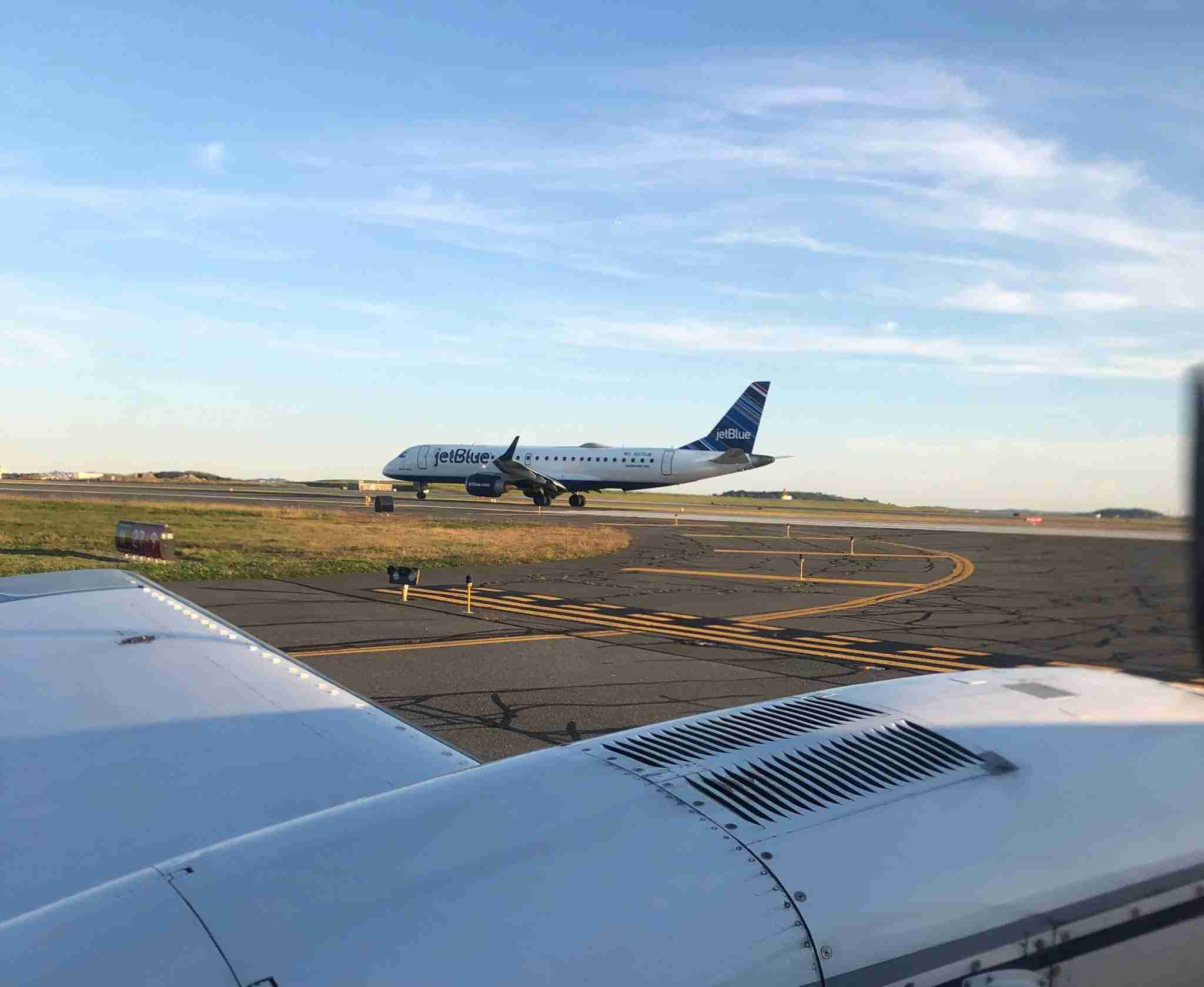 Cape Air flights depart with normal traffic from Boston Logan, here waiting for a JetBlue Embraer 190 to take off. (Photo by Edward Russell/TPG)