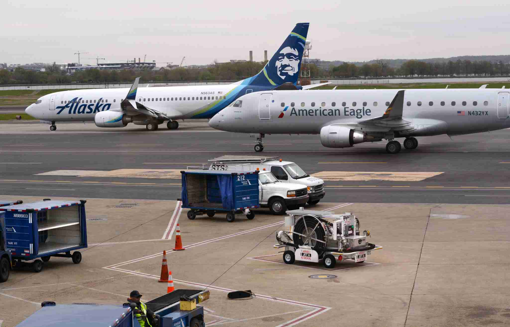WASHINGTON, D.C. - APRIL 24, 2018: An Alaska Airlines and American Eagle jet taxi toward the runway at Ronald Reagan Washington National Airport in Washington, D.C. (Photo by Robert Alexander/Getty Images)