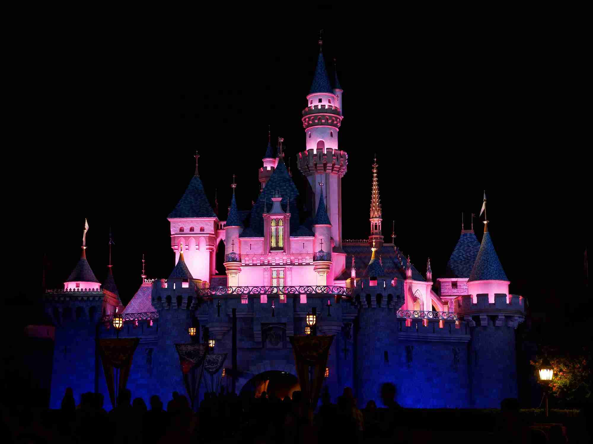 Exterior image of entrance to Sleeping Beauty Castle in Disneyland as seen at night.