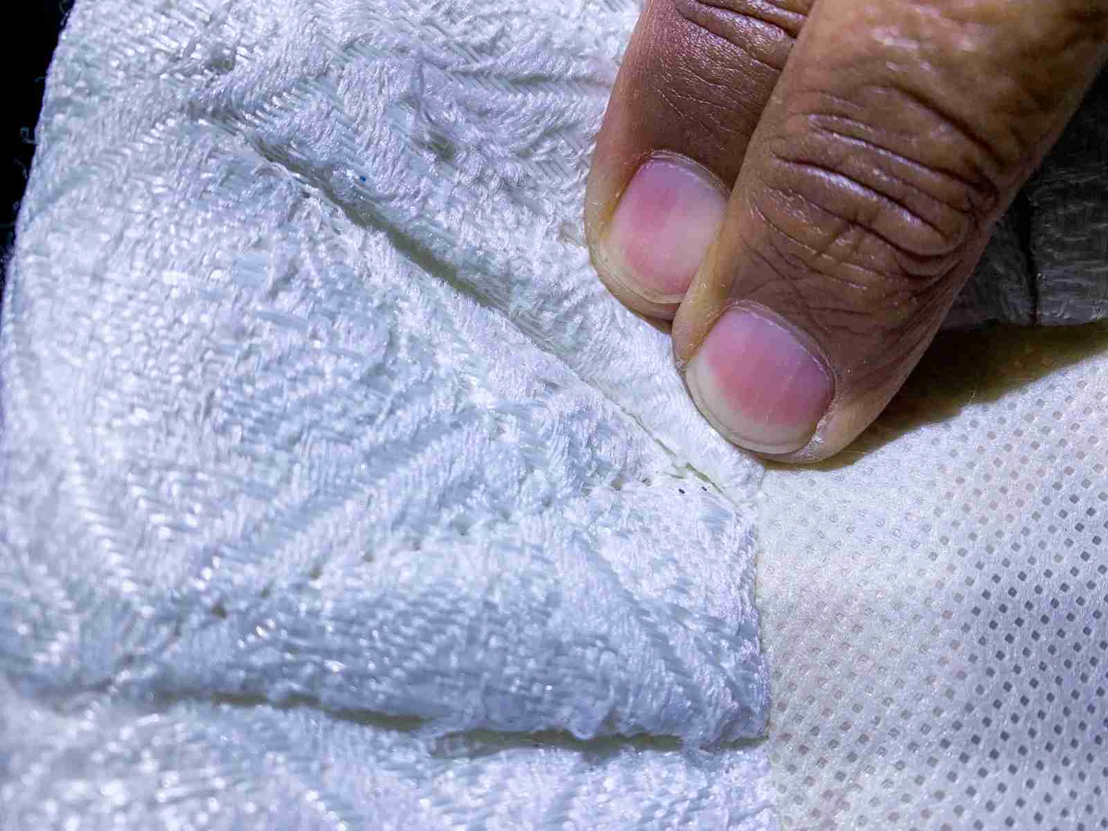 Mattress folds are a great place to look for evidence of bed bugs (Photo by Summer Hull/The Points Guy)