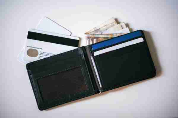 Wallet with cash and credit cards. (Photo by Getty Images)