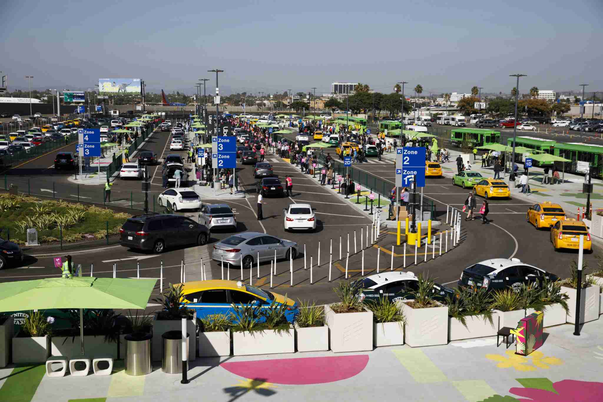 Vehicles from Uber Technologies Inc., Lyft Inc., and taxi cabs enter the LAX-it centralized pickup area at Los Angeles International Airport (LAX) in Los Angeles, California, U.S., on Tuesday, Oct. 29, 2019. On Tuesday, Los Angeles International Airport