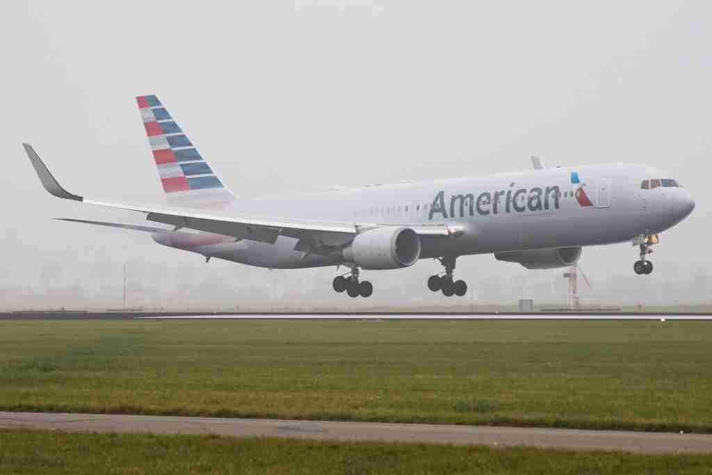 American Airlines Boeing 767-300 landing in the mist in Amsterdam Schiphol International Airport. American connects Amsterdam to Philadelphia and seasonal to Dallas / Fort Worth. The airplane is Boeing 767-323(ER)(WL) with registration N394AN and is flying for American Airlines since June 1998. American Airlines operates a fleet of 931 airplanes and has on order 243 more. (Photo by Nicolas Economou/NurPhoto via Getty Images)