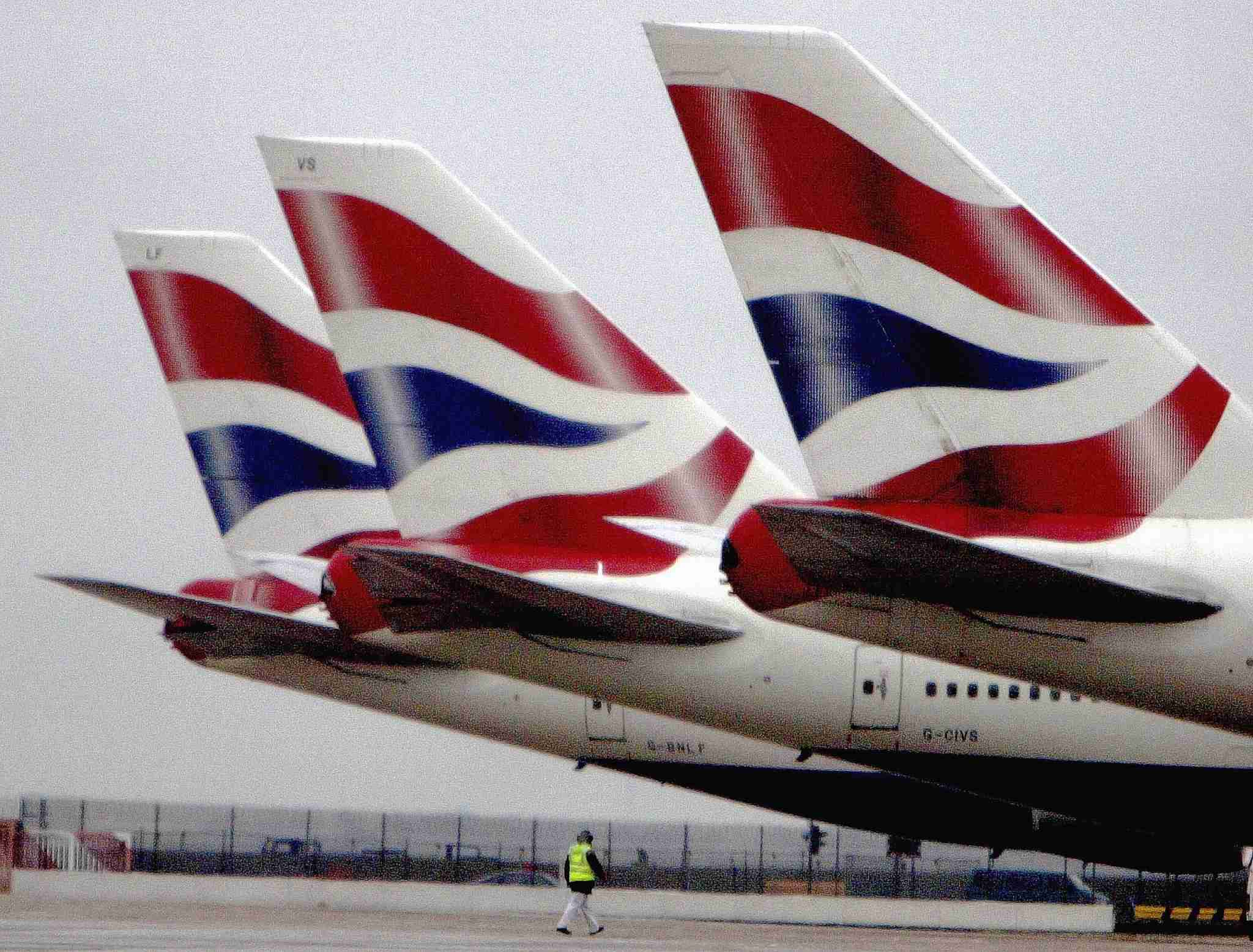 Tails of British Airways planes are seen at the terminal. (Photo by Ian Waldie/Getty Images)