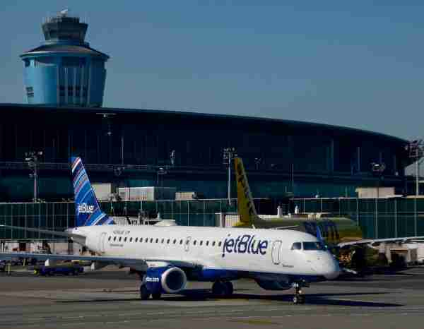 NEW YORK, NY - OCTOBER 4, 2017:  A JetBlue passenger jet (Embraer 190) taxis at LaGuardia Airport in New York, New York. (Photo by Robert Alexander/Getty Images)