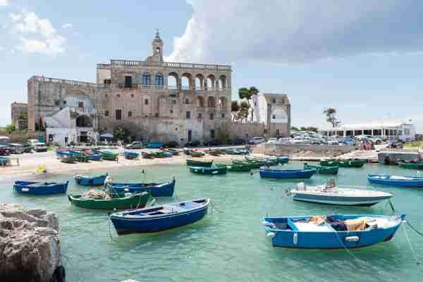 San Vito port with old abbaye in the background dating 16th century abbey. Polignano a Mare, Bari province, Puglia, Italy