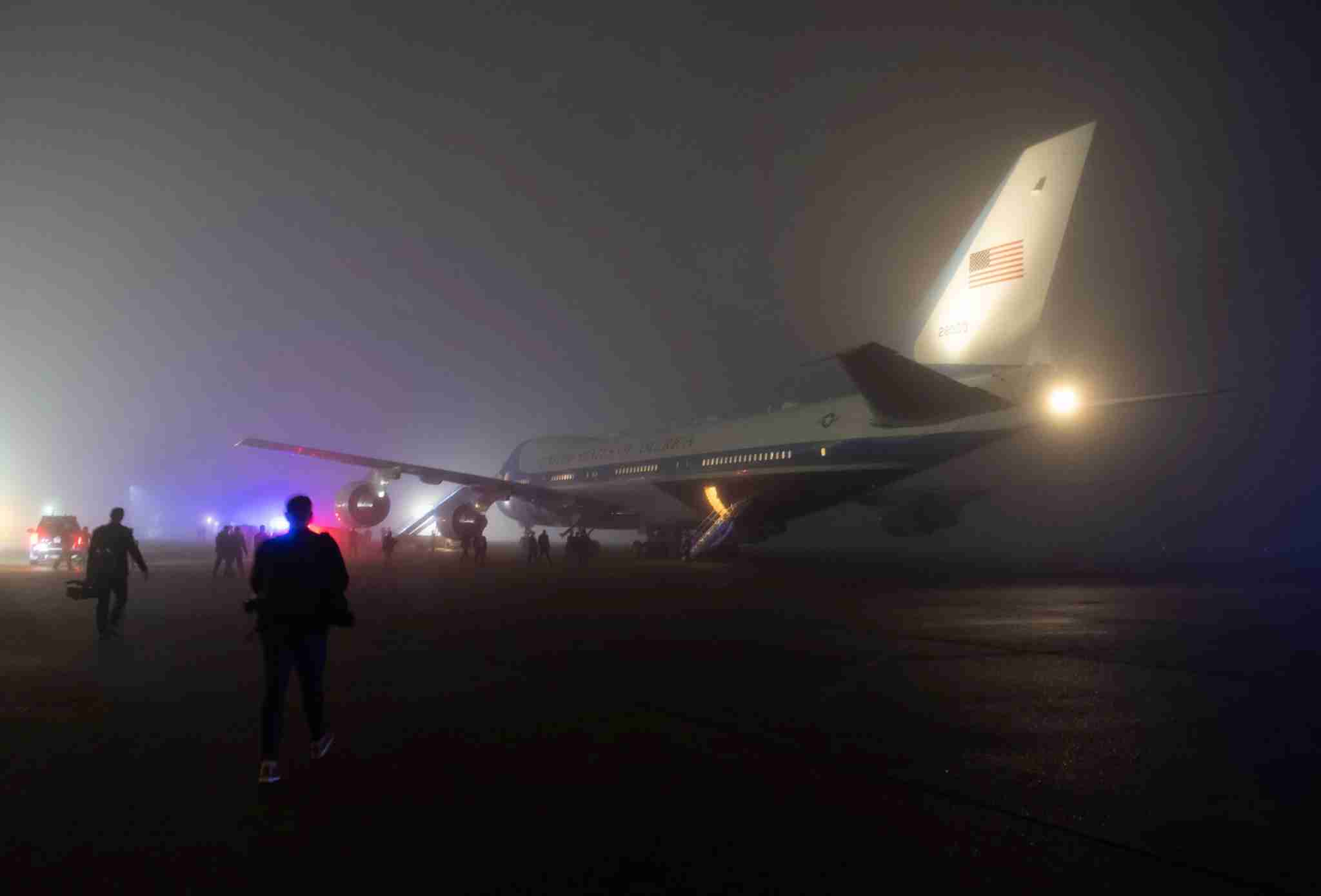 Reporters and staff board Air Force One in heavy fog prior to departing from Louis Armstrong New Orleans International Airport in Kenner, Louisiana, January 14, 2020, as US President Donald Trump and First Lady Melania Trump travel to attend the College Football Playoff National Championship game. (Photo by SAUL LOEB / AFP) (Photo by SAUL LOEB/AFP via Getty Images)