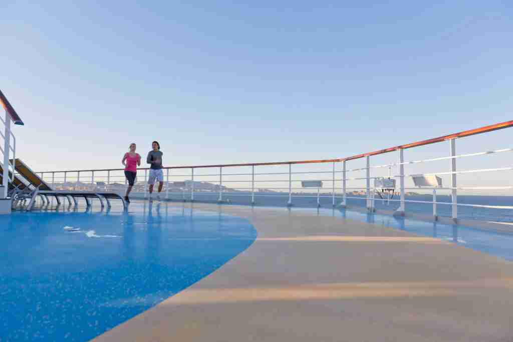 Young couple is jogging around the shipdeck of a cruise ship, Mediterranean Sea Westend61 / Getty Images.
