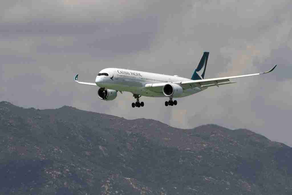 An Airbus SE A350 aircraft operated by Cathay Pacific Airways Ltd. prepares to land at Hong Kong International Airport in Hong Kong, China, on Saturday, August 12, 2017. With the company expected to announce another loss this week, Cathay needs to shift strategy from being the region