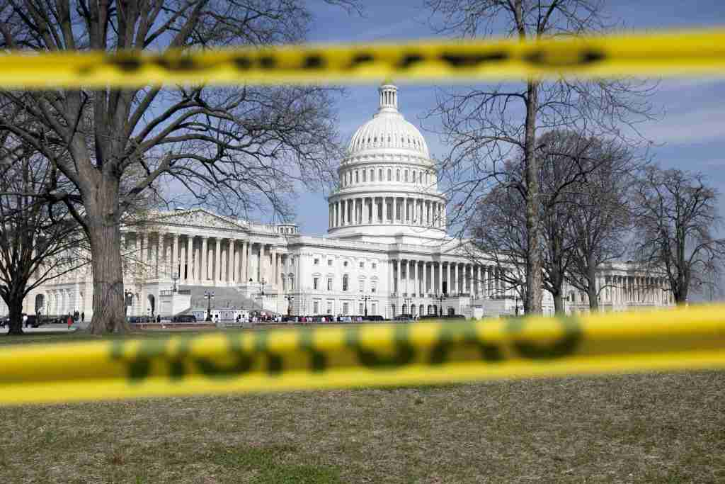 The Capitol building stands behind caution tape at a construction site in Washington, D.C., U.S. Photographer: Andrew Harrer/Bloomberg