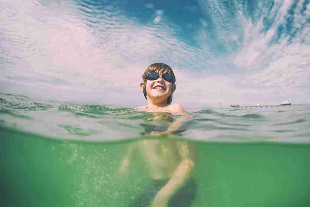 boy swimming in Florida Gulf Coast