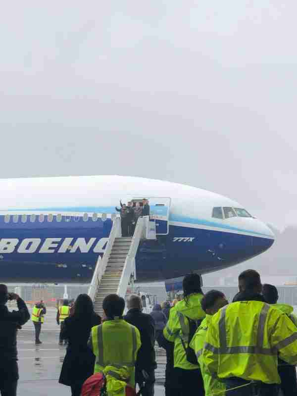 The two pilots are met by Boeing executives as they exit the 777-9 after completing its first test flight. (Photo by Zach Wichter/The Points Guy.)