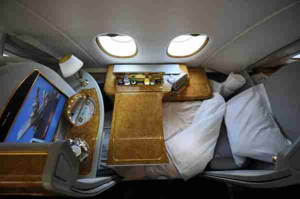 A first class seat configured for sleeping aboard an Emirates Airlines A380 on August 1, 2008. Emirates becomes the first commercial Airbus A380 jet to land in the United States at JFK International Airport in New York. The A380 is the world's largest airliner with 49 percent more floor space and 35 percent more seating than the previous largest aircraft. AFP PHOTO/Stan HONDA (Photo credit should read STAN HONDA/AFP/Getty Images)