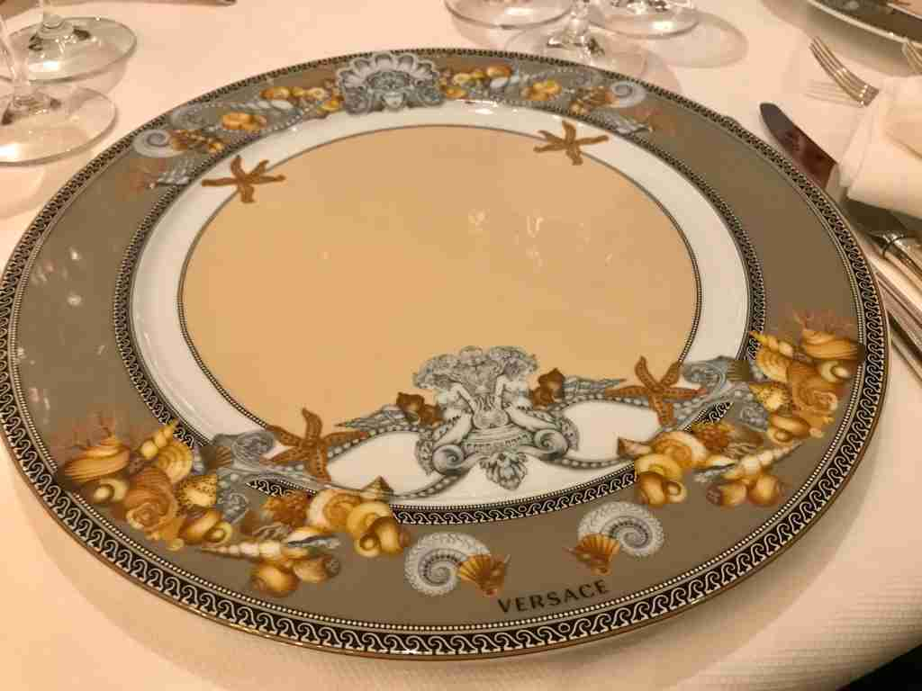 The plates in the Compass Rose dining room are by Versace. (Photo by Gene Sloan/The Points Guy)