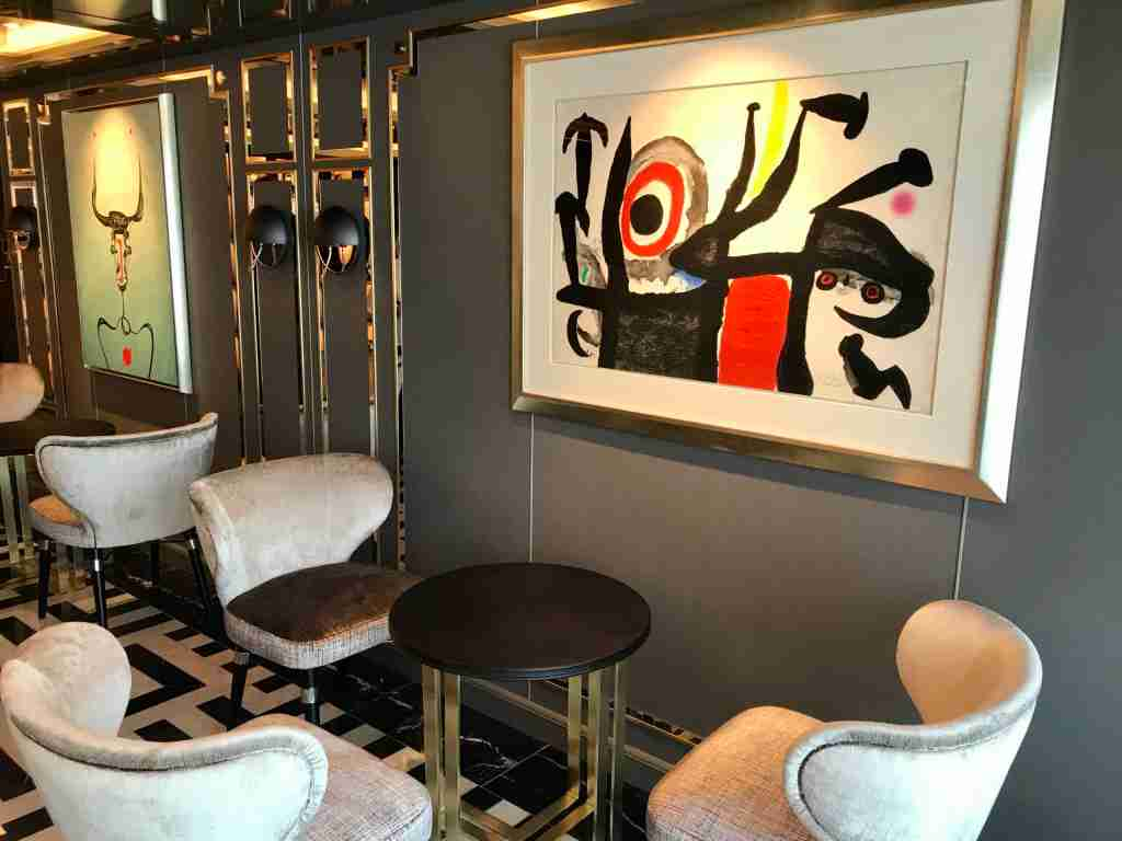 An art work by Joan Miro will be your companion during drinks in the Prime 7 steakhouse bar on Seven Seas Splendor. The room also has a Picasso. (Photo by Gene Sloan/The Points Guy)