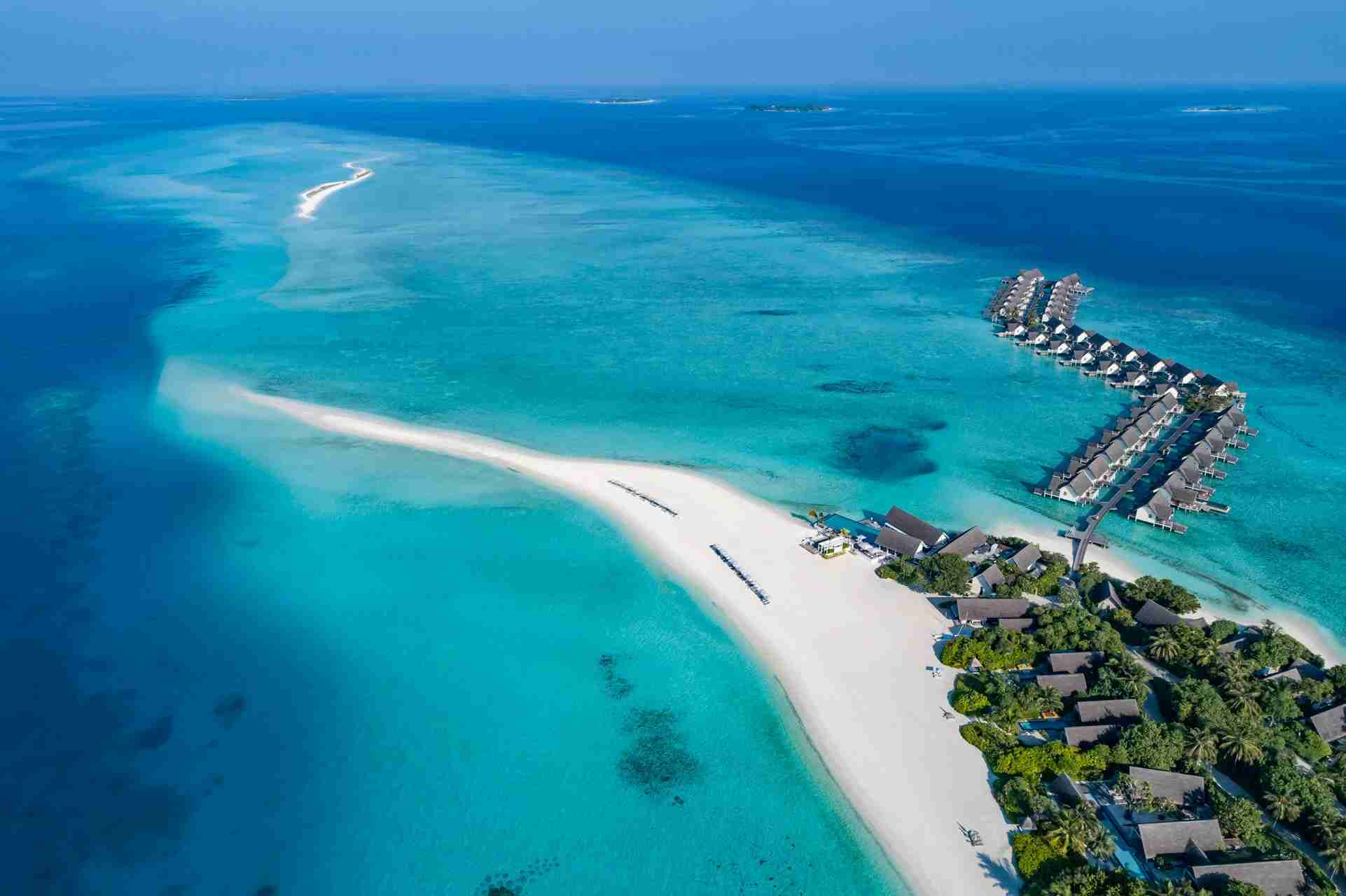 White-sand beaches, crystal-clear water and luxury resorts with overwater bungalows such as the Four Seasons Resort Maldives Laadaa Giraavaru, shown here, are top allures of the Maldives. (Photo courtesy of Four Seasons).