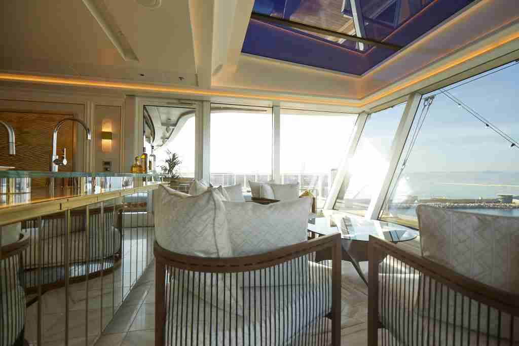 The Winter Garden in the Regent Suite has floor-to-ceiling windows with views over the ship