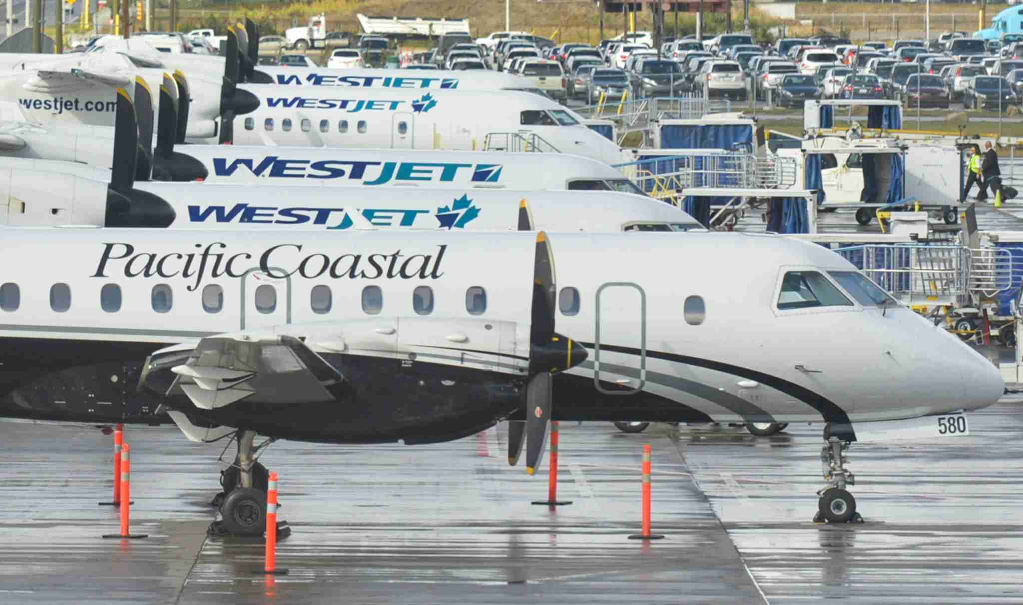 A lineup of regional turboprop planes that fly for WestJet are seen at Calgary International Airport on Sept. 10, 2018 (Photo by Artur Widak/NurPhoto via Getty Images)