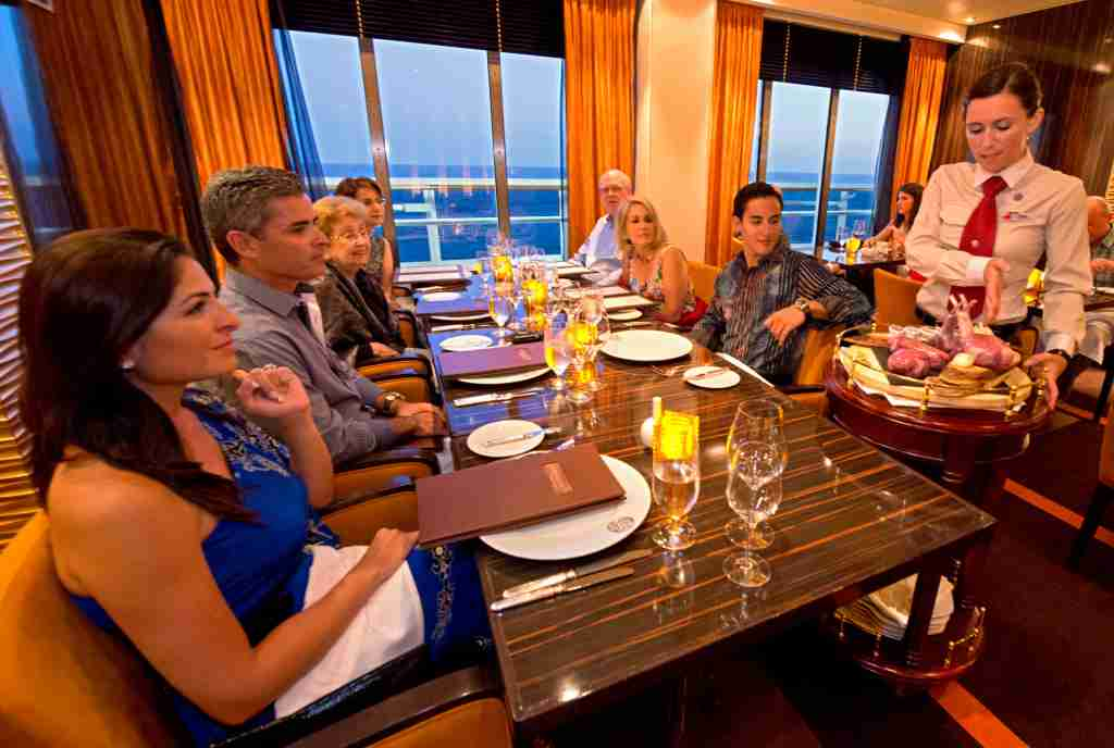 A server presents entree options at the Fahrenheit 555 steakhouse on Carnival Breeze. (Photo by Andy Newman/Carnival Cruise Line).