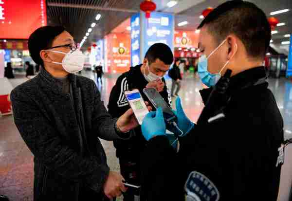 A green QR code shows his health status to security upon arrival at Wenzhou railway station in Wenzhou. (Photo by NOEL CELIS/AFP/Getty Images)