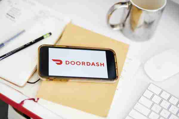 Doordash Inc. signage is displayed on an Apple Inc. iPhone in an arranged photograph taken in the Brooklyn borough of New York, U.S., on Friday, Jan. 10, 2020. Wall Street is weighing reports thatGrubhub Inc.is exploring strategic options in the midst of intense competition and steep discounts, giving fresh impetus to the idea that food-delivery companies have no choice but to merge or acquire. Photographer: Gabby Jones/Bloomberg via Getty Images