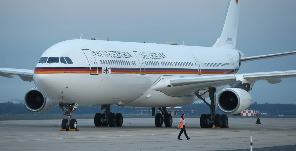 BERLIN, GERMANY - AUGUST 05: The Konrad Adenauer, one of the planes used by leading German politicians, including German Chancelor Angela Merkel and President Joachim Gauck, stands at the military portion of Tegel Airport on August 5, 2014 in Berlin, Germany. The Konrad Adenauer is a modified Airbus A340. (Photo by Sean Gallup/Getty Images)