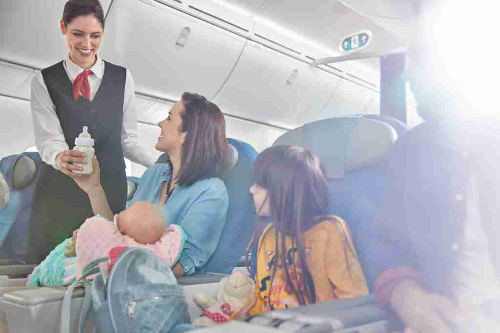 baby mother and flight attendant
