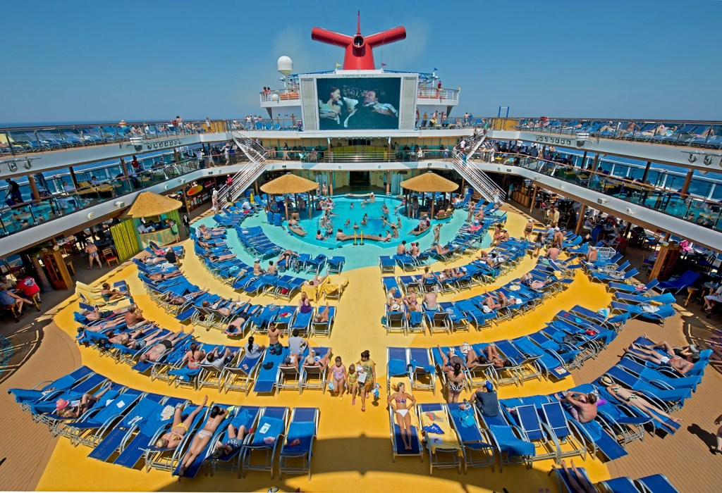 """Carnival Breeze Seaside Theatre, a lido deck poolside 270-square-foot LED screen offering nightly """"Dive In Movies,"""" along with concerts, sporting events and other programming throughout the day. (Photo by Andy Newman / Carnival Cruise Line)"""