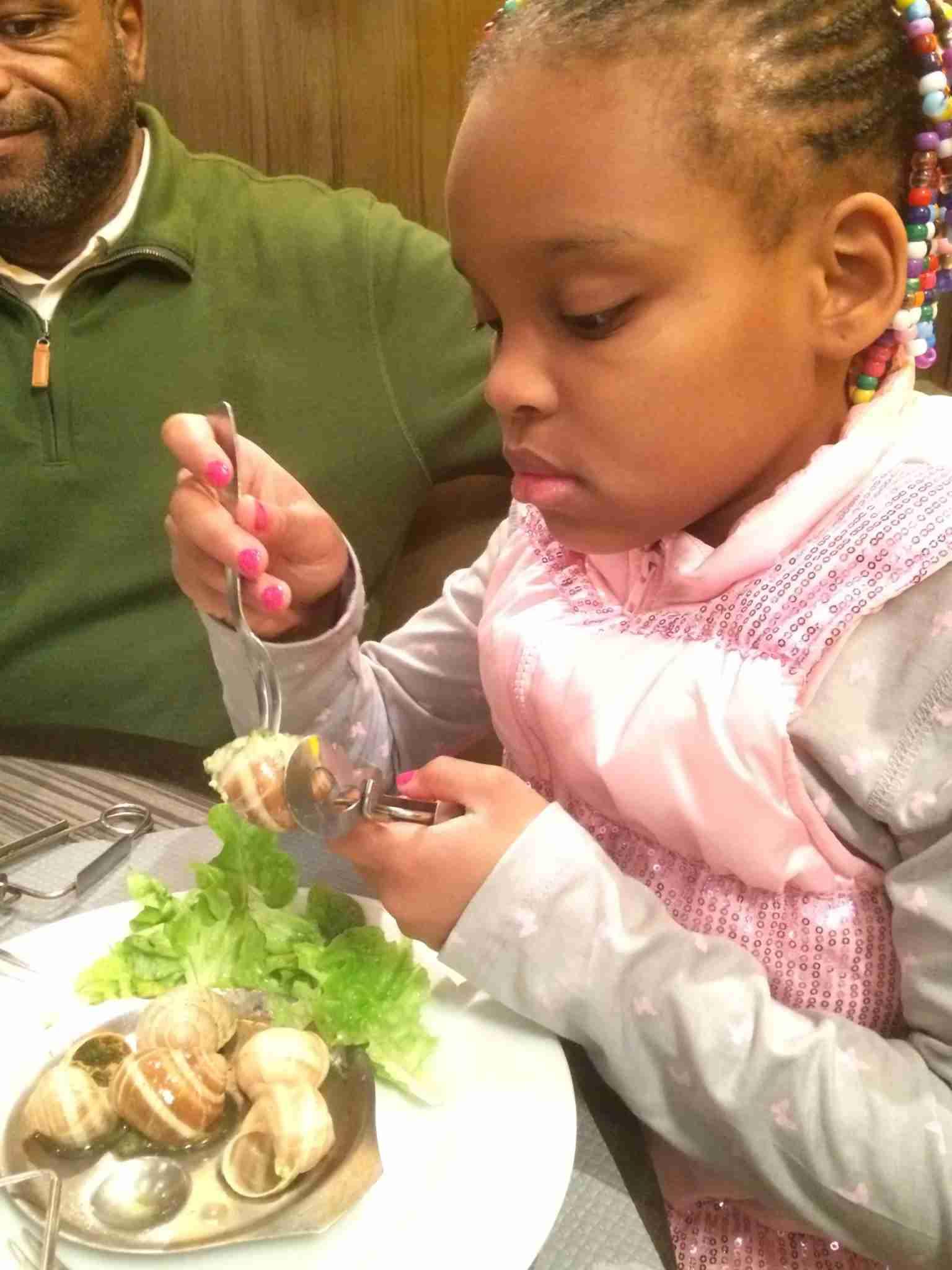 My daughter enjoying escargot during a Christmas trip to Paris. (Photo by Benét J. Wilson/The Points Guy)