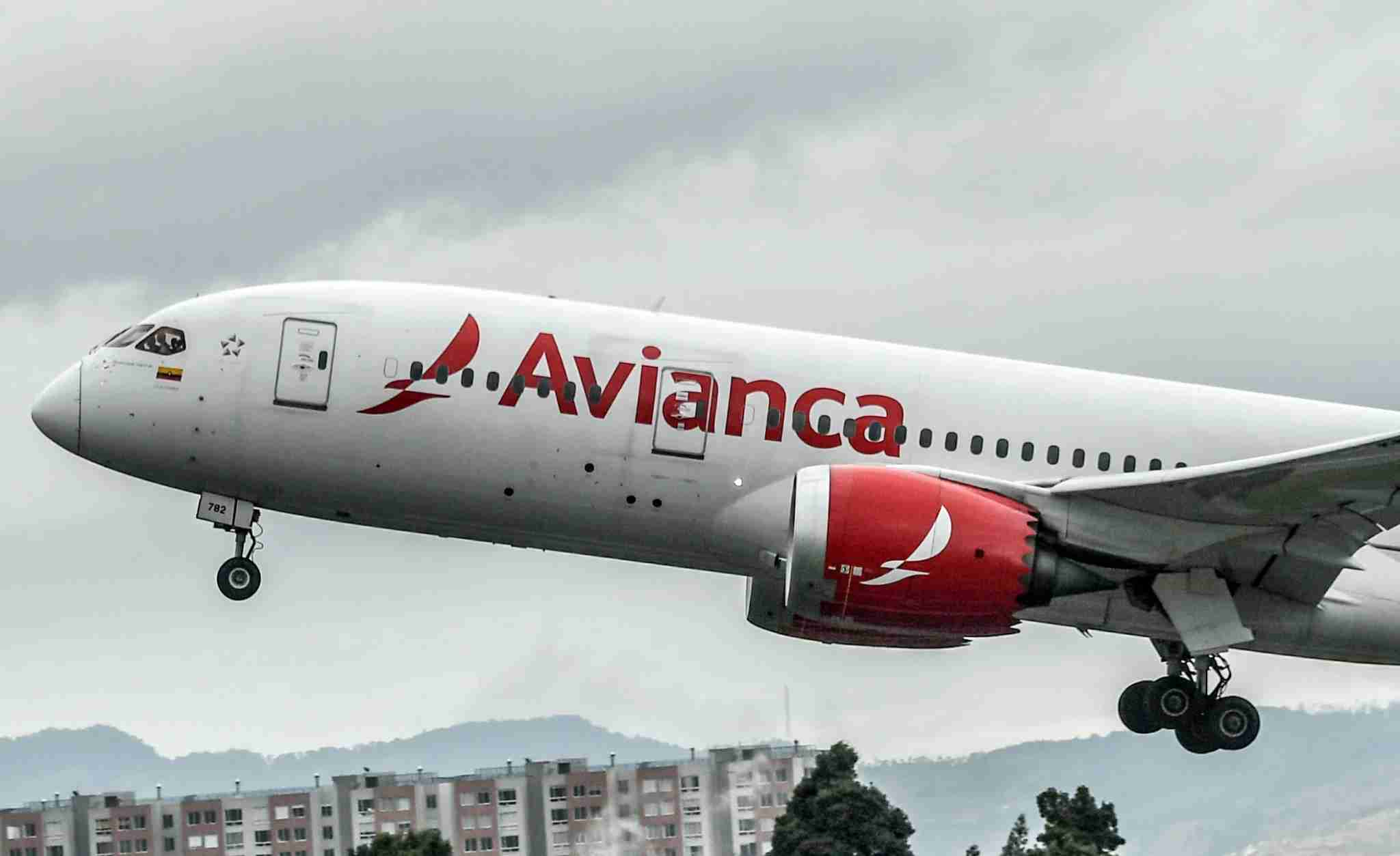 """An aircraft of Colombian company Avianca lands at El Dorado International Airport in Bogota on August 28, 2019. - Avianca Holdings, the largest airline in Colombia and the second largest in Latin America, denied being bankrupt on August 27 after a leaked video in which the president of the board of directors ensures that the company is """"broken"""" went viral in social media. (Photo by Juan BARRETO / AFP) (Photo credit should read JUAN BARRETO/AFP via Getty Images)"""