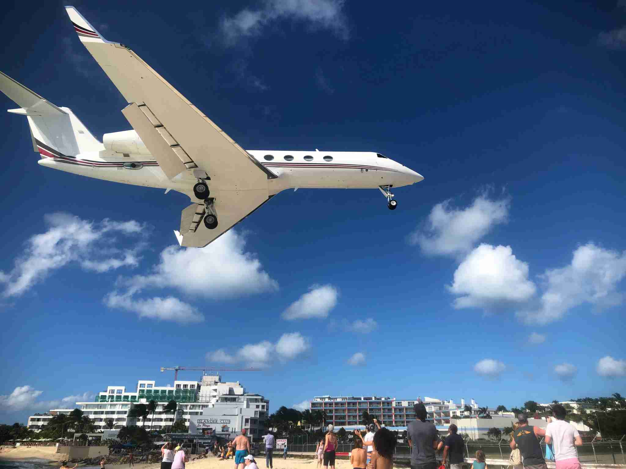 Plane flying over beach by Erin Carey