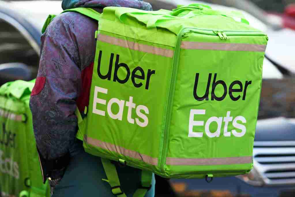 Delivery Cyclist with Green Uber Eats Backpack