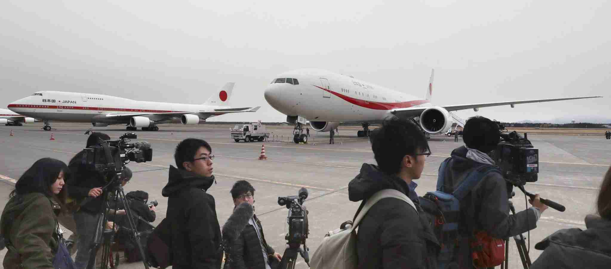The new government Boeing 777-300 ER (R) is shown to the press at the Japan Air Self-Defense Force