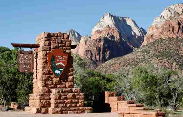 SPRINGDALE, UT - MAY 14: A sign hangs at the entrance to Zion National Park on May 14, 2020 in Springdale, Utah. Zion National Park had a limited reopening yesterday as part of its reopening plan after it was closed due to the COVID-19 pandemic. (Photo by George Frey/Getty Images)