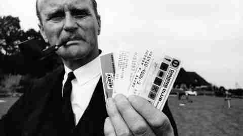 Black and white photos of man holding Diners Club credit cards in 1960