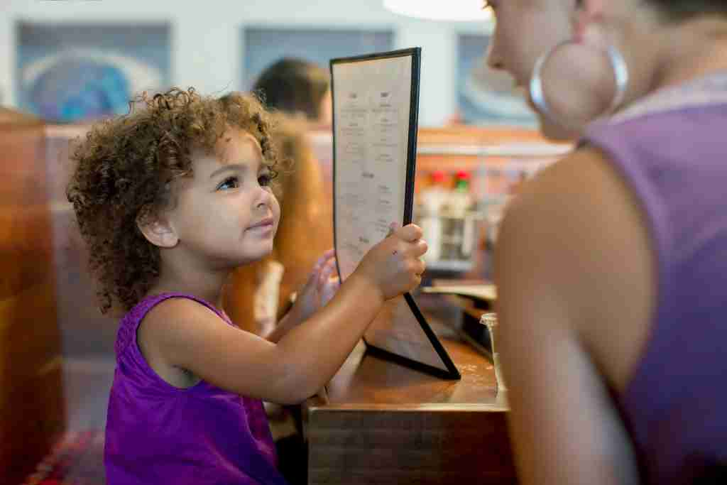 child ordering off restaurant menu