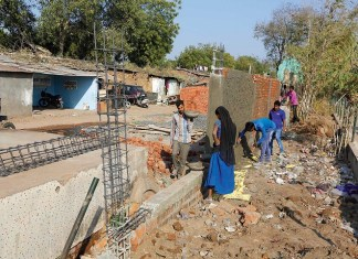 """Government is Building wall to """"Cover the Slums of Ahmedabad from the Sight of US President""""_The_Policy_Times"""