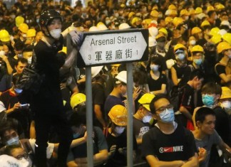 Hong Kong's Fight for Democracy Continues; People Wearing Yellow Masks to Show Support during the Covid Period_The PolicyTimes