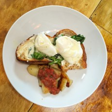 Egg Florentine alla Coocoo - Sourdough Bread, Poached Eggs, Spinach, Creamy Blue Cheese Sauce served with Potatoes & Spicy Salsa