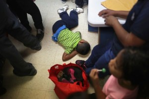 MCALLEN, TX - NOVEMBER 01: Immigrant asylum seekers wait to receive aid at the Humanitarian Respite Center after being released by U.S. Customs and Border Protection (CBP), on November 1, 2018 in McAllen, Texas. Days before U.S. midterm elections President Donald Trump announced plans to deny asylum seekers who don't present themselves at official ports of entry. The number of families seeking asylum has surged along the southern border, especially in South Texas' Rio Grande Valley in 2018, despite stricter border enforcement policies. (Photo by John Moore/Getty Images)