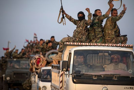 Syrian government forces drive along a road in the countryside of the northeastern Syrian city of Qamishli on October 25, 2019. - Damascus and Moscow deployed extra forces to Syria's border with Turkey, even as Washington partially reversed a drawback to boost its own military presence near key Syrian oil fields. (Photo by - / AFP) (Photo by -/AFP via Getty Images)